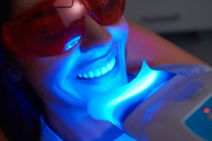 woman getting in-office teeth whitening from her dentist in South Jersey